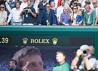 Novak Djokovic's Wife Jelena and Son Stefan on Centre Court during the presentation of his fourth  Championship Trophy