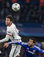 Maxwell of Paris Saint-Germain beats Pedro of Chelsea in the air during the UEFA Champions League Round of 16 2nd leg match between Chelsea and PSG at Stamford Bridge, London, England on 9 March 2016. Photo by Andy Rowland.