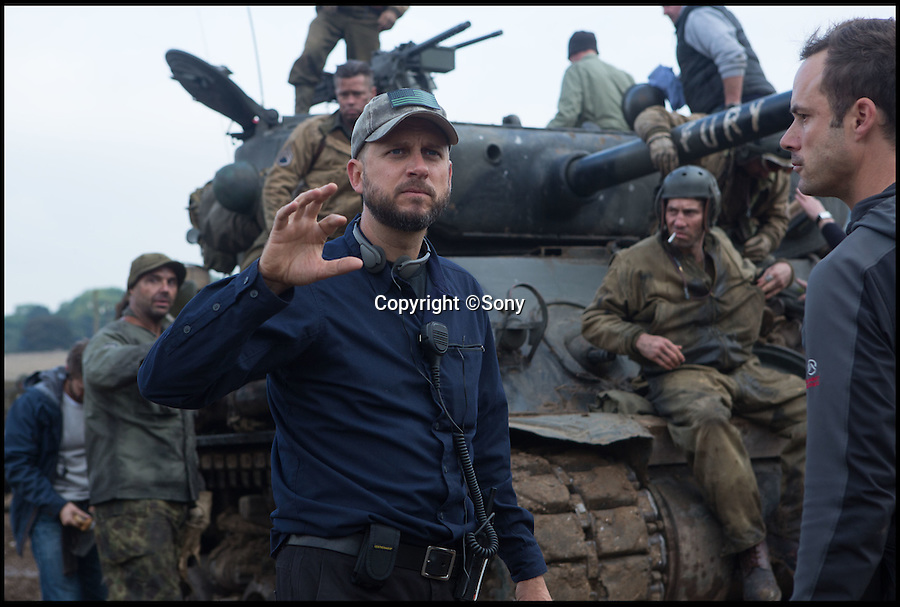 BNPS.co.uk (01202 558833)<br /> Pic: Sony/BNPS<br /> <br /> ***Please Use Full Byline***<br /> <br /> Director David Ayer on the set of FURY.<br /> <br /> Meet the real driving force behind Brad Pitt's new Second World War blockbuster, Fury.<br /> <br /> Tank mechanics Brian Frost, 39, and Ian 'Buzz' Aldridge, 53, were hired to drive the famous Sherman tank the movie is named after for most of the major scenes.<br /> <br /> The pair, who work at Bovington Tank Museum in Dorset, spent six months taking it in turns to operate the 26 ton tank in front of the cameras.<br /> <br /> Although the two never appear in the movie, every time 'Fury' is seen in motion and without actor Michael Pena in the driving seat,<br /> Brian or Buzz are at the controls.<br /> <br /> The pair also trained actor Pena the basics of driving the Sherrman tank to give the close-up shots of his character Corporal Trini 'Gordo' Garcia more legitimacy.<br /> <br /> The museum lent the movie's producers their M4 Sherman tank to act as Fury as well as the services of Brian and Buzz.
