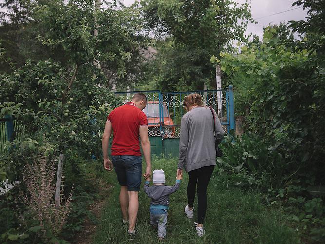 Katrine, Alexander and his nephew walk in grandparents house. Rascov, Transnistria