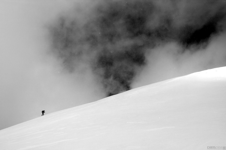 A lone skier tracks their way up a powder slope near the Sangree Froelicher Hut above Leadville, Colorado.
