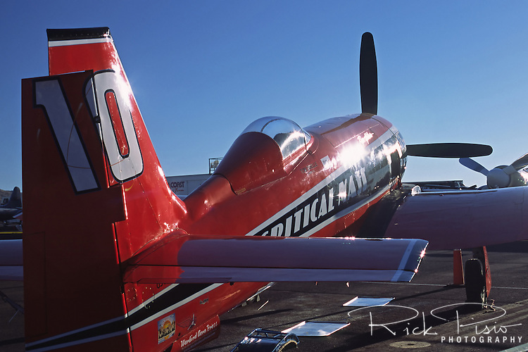 "The morning sun reflects off the fuselage of the highly modified Hawker Sea Fury and Unlimited Class Air Racer ""Critical Mass"" in the pit area during the 2003 Reno National Championship Air Races"