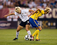 Lori Lindsey (5) of the USWNT fights for the ball with Josefine Oqvist (14) of Sweden at Rentschler Field in East Hartford, Connecticut.  The USWNT defeated Sweden, 3-0.