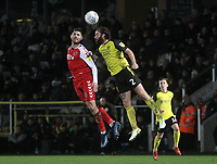 Fleetwood Town's Ched Evans jumps with  Burton Albion's John Brayford<br /> <br /> Photographer Mick Walker/CameraSport<br /> <br /> The EFL Sky Bet League One - Burton Albion v Fleetwood Town - Saturday 11th January 2020 - Pirelli Stadium - Burton upon Trent<br /> <br /> World Copyright © 2020 CameraSport. All rights reserved. 43 Linden Ave. Countesthorpe. Leicester. England. LE8 5PG - Tel: +44 (0) 116 277 4147 - admin@camerasport.com - www.camerasport.com