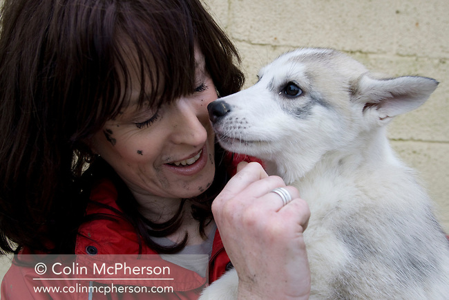 Debbie Pullen pictured with a 12-week-old husky at her farm at Staintondale, north Yorkshire. In September 2006, Debbie and her husband Michael set up Pesky Husky Trekking, which allows visitors to their farm the experience of being pulled on a scooter by Siberian huskies either on a purpose-built training track or a nearby disused railway line. By diversifying their farming business they were aiming to make their farm more financially viable.
