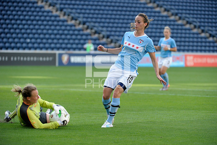 Sky Blue FC goalkeeper Kristin Luckenbill (18) makes a save in front of Chicago Red Star forward Kosovare Asllani (10).  The  Chicago Red Stars defeated the Sky Blue FC 2-0 at Toyota Park in Bridgeview, IL on July 10, 2010.