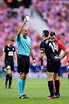 Dani Garcia Carrillo of SD Eibar (R) gets a yellow card from FIFA Referee Alvarez Izquierdo (L) during the La Liga match between Atletico Madrid and Eibar at Wanda Metropolitano Stadium on May 20, 2018 in Madrid, Spain. Photo by Diego Souto / Power Sport Images