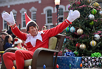 STAFF PHOTO BEN GOFF  @NWABenGoff -- 12/13/14 The Boy Scouts of America Pack 36 'Elf on the Shelf' waves from the pack's float during the Bentonville Christmas parade through downtown on Saturday Dec. 13, 2014.