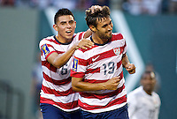 PORTLAND, Ore. - July 9, 2013: Chris Wondolowski and Joe Corona celebrate after Wondolowski's third goal The US Men's National team plays the National team of Belize during the 2013 Gold Cup at at JELD-WEN Field.