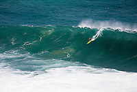 First place winner John John Florence riding a wave at the 2016 Big Wave Eddie Aikau Contest, Waimea Bay, North Shore, Oahu