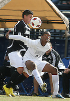 Robert Burnett #22 of Georgetown University holds up Andrew Sousa #10 of Providence University during a Big East quarter-final  match at North Kehoe Field, Georgetown University on November 6 2010 in Washington D.C. Providence won 2-1.