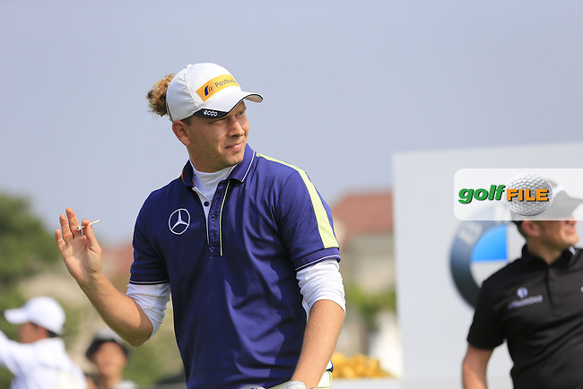 Marcel Siem (GER) tees off the 1st tee to start his match during Sunday's Final Round of the 2014 BMW Masters held at Lake Malaren, Shanghai, China. 2nd November 2014.<br /> Picture: Eoin Clarke www.golffile.ie