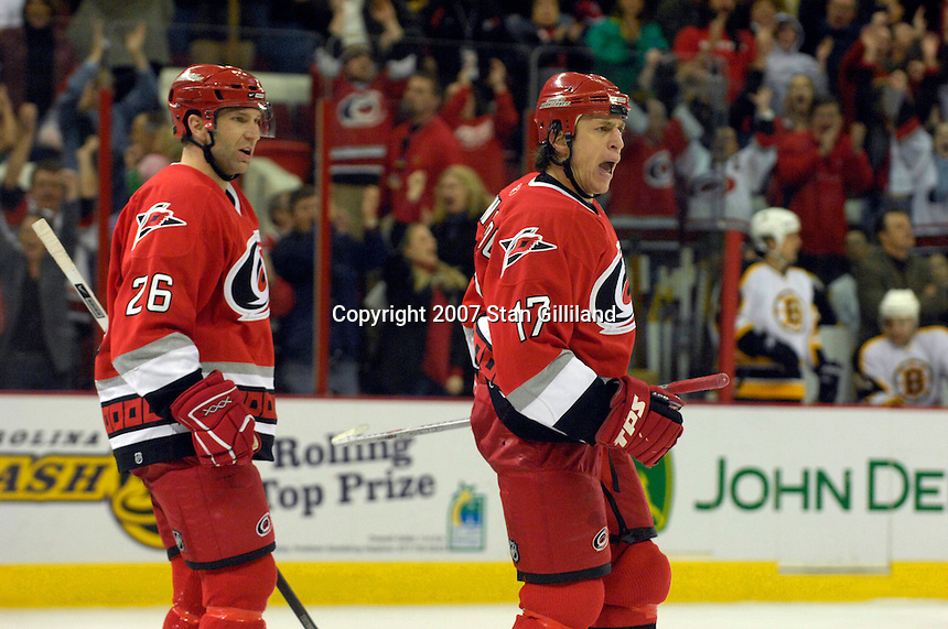 Carolina Hurricanes' Rod Brind'Amour (17) celebrates his third period goal as teammate Erik Cole (26) skates up behind Saturday, Feb. 3, 2007 at the RBC Center in Raleigh. Boston won 4-3 in overtime.