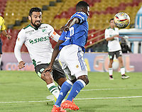 BOGOTA - COLOMBIA -17 -08-2016: Dairon Asprilla (Der) jugador de Millonarios disputa el balón con Andres Perez (Izq) jugador de Deportivo Cali durante partido por la fecha 13 de la Liga Aguila II 2016 jugado en el estadio Nemesio Camacho El Campin de la ciudad de Bogota./ Dairon Asprilla (R) player of Millonarios fights for the ball with Andres Perez (L) player of Deportivo Cali during match for the date 13 of the Liga Aguila II 2016 played at the Nemesio Camacho El Campin Stadium in Bogota city. Photo: VizzorImage / Gabriel Aponte / Staff.