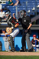 Umpire Brandin Sheeler calls a strike behind catcher Korey Dunbar (43) during the first game of a doubleheader between the Mahoning Valley Scrappers and Batavia Muckdogs on July 2, 2015 at Dwyer Stadium in Batavia, New York.  Batavia defeated Mahoning Valley 4-1.  (Mike Janes/Four Seam Images)