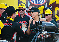 Oct 7, 2018; Ennis, TX, USA; NHRA top fuel driver Steve Torrence (left) is congratulated by Leah Pritchett after winning the Fall Nationals at the Texas Motorplex. Mandatory Credit: Mark J. Rebilas-USA TODAY Sports