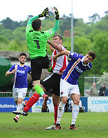 Exeter City's Christy Pym claims a high ball under pressure from Lincoln City's Matt Rhead<br /> <br /> Photographer Chris Vaughan/CameraSport<br /> <br /> The EFL Sky Bet League Two Play Off First Leg - Lincoln City v Exeter City - Saturday 12th May 2018 - Sincil Bank - Lincoln<br /> <br /> World Copyright &copy; 2018 CameraSport. All rights reserved. 43 Linden Ave. Countesthorpe. Leicester. England. LE8 5PG - Tel: +44 (0) 116 277 4147 - admin@camerasport.com - www.camerasport.com