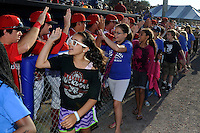 Batavia Muckdogs players give high fives to young fans before a game against the Auburn Doubledays on June 18, 2013 at Dwyer Stadium in Batavia, New York.  Batavia defeated Auburn 10-2.  (Mike Janes/Four Seam Images)