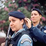 Patrol officers Luciana Montanari, 32, left, and Carla Bonn, 33, right. <br /> Rapid Response Team<br /> Pacifying Police Unit<br /> Complexo do Caju, Rio de Janeiro, Brazil