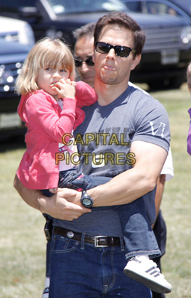 """ELLA RAE & MARK WAHLBERG.The 20th annual """"A Time for Heroes"""" Celebrity Carnival benefiting Elizabeth Glaser Pediatric AIDS Foundation held at Wadsworth Theater on the Veteran Administration Lawn in West Los Angeles, California, USA. .June 7th, 2009.half length grey gray t-shirt carrying lifting daughter dad father family pink jacket sunglasses shades tongue.CAP/DVS                                                  .©Debbie VanStory/Capital Pictures."""