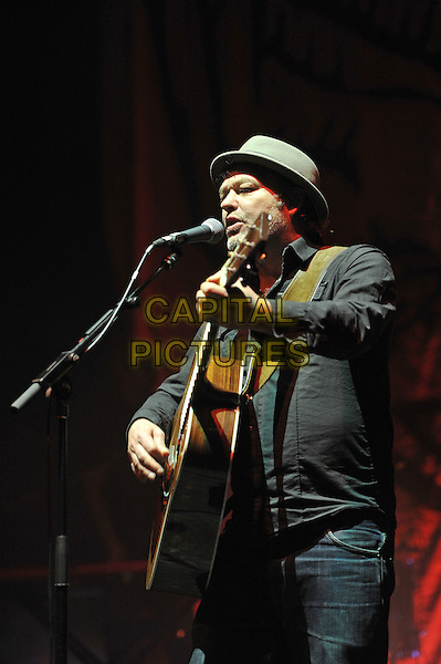 Mark Chadwick.Levellers performing live in concert, Brixton Academy, London, England. 18th December 2011.on stage gig performance music half length  singing hat guitar black shirt .CAP/MAR.© Martin Harris/Capital Pictures.