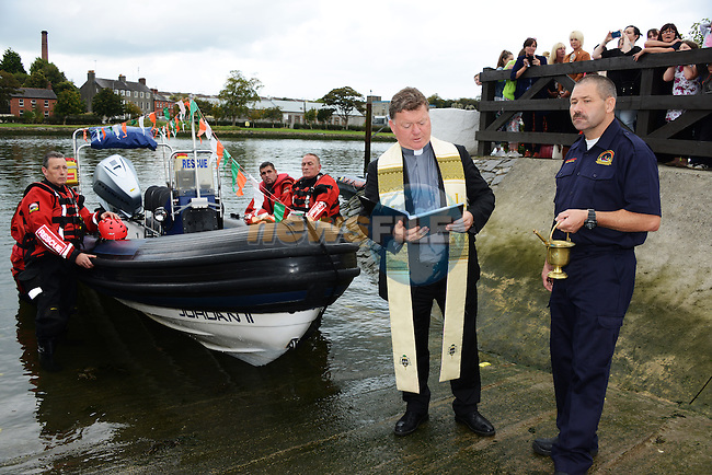 Fr. Phil Gaffney, PP of St. Mary's, blessing the new rescue boat at the Boyne Fishermen's Rescue and Recovery Service Open Day.