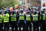 "© Joel Goodman - 07973 332324 . 11/06/2017 . Manchester , UK . Anti fascist protesters . Demonstration against Islamic hate , organised by former EDL leader Tommy Robinson's "" UK Against Hate "" and opposed by a counter demonstration of anti-fascist groups . UK Against Hate say their silent march from Piccadilly Train Station to a rally in Piccadilly Gardens in central Manchester is in response to a terrorist attack at an Ariana Grande concert in Manchester , and is on the anniversary of the gun massacre at the Pulse nightclub in Orlando . Photo credit : Joel Goodman"