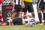 Juventus' player Roman Macek lies injured during the South China vs Juventus match of the AET International Challenge Cup on 30 July 2016 at Hong Kong Stadium, in Hong Kong, China.  Photo by Marcio Machado / Power Sport Images