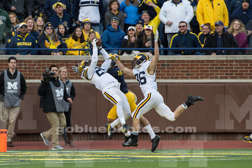 The University of Michigan Maize team beats the Blue team, 14-13, in the annual spring football game at Michigan Stadium on April 1, 2016.