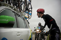 Lars Bak (DEN/Lotto-Soudal) checking his blooded teeth in the reflection of the Orica-GreenEDGE car after having crashed in De Moeren. Forceful +80km/h winds blew several riders off their bikes. 3 riders needed to abandon the race here.<br /> <br /> 77th Gent-Wevelgem 2015