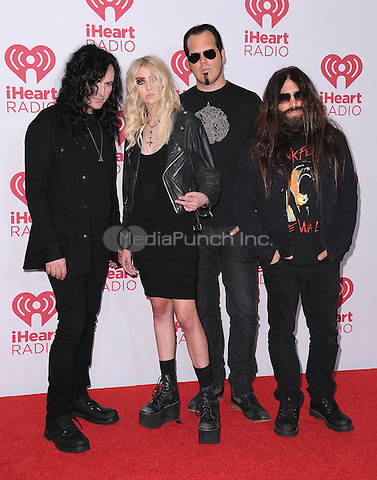 LAS VEGAS, NV - SEPTEMBER 19:  The Pretty Reckless with Taylor Momsen at the 2014 iHeartRadio Music Festival at the MGM Grand Garden Arena on September 19, 2014 in Las Vegas, Nevada. PGSK/MediaPunch