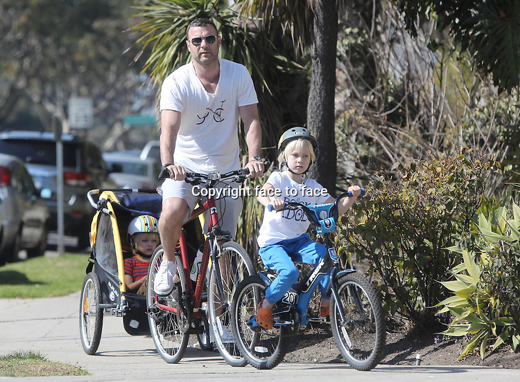 BRENTWOOD, CA - FEBRUARY 23: Liev Schreiber with sons Alexander and Sasha enjoy a day of bike riding and climging in Brentwood, California on February 23, 2014. Credit: MediaPunch<br />