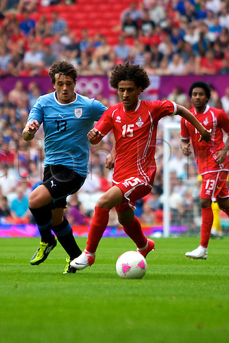 26.07.2012 Manchester, England. United Arab Emirates midfielder Omar Abdulrahman and Uruguay defender Matías Aguirregaray in action during the first round group A mens match between United Arab Emirates and Uruguay at Old Trafford.