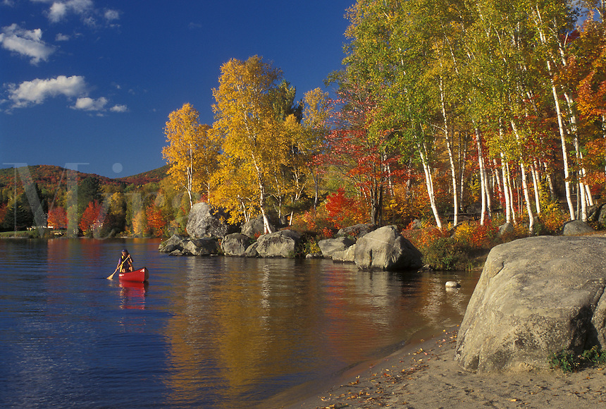 autumn, canoeing, canoe, VT, Vermont, Woman paddling a red canoe along Boulder Beach on Lake Groton in Groton State Forest in the fall.
