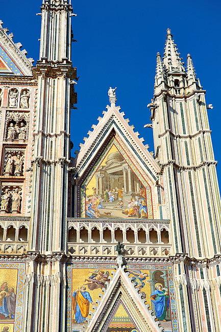 Close up of a gable with mosaics depicting the life of Mary  created between 1350 and 1390 after designs by artist Cesare Nebbia on the14th century Tuscan Gothic style facade of the Cathedral of Orvieto, designed by Maitani, Umbria, Italy