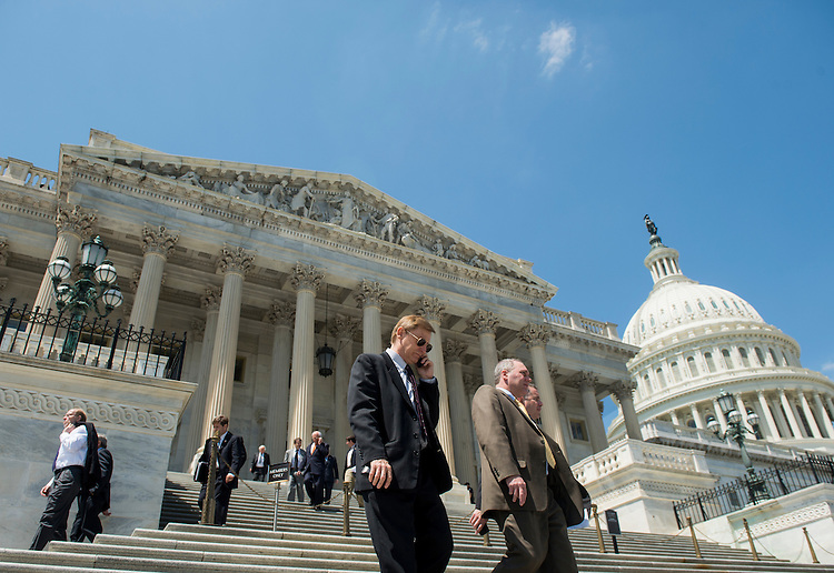 UNITED STATES - APRIL 26: From left, Rep. Spencer Bachus, R-Ala., Rep. Steve Scalise, R-La., and Rep. Bruce Braley, D-Iowa, along with other members of Congress walk down the House steps of the Capitol following votes on the FAA sequestration and an amendment to the Helium Act on Friday, April 26, 2013.