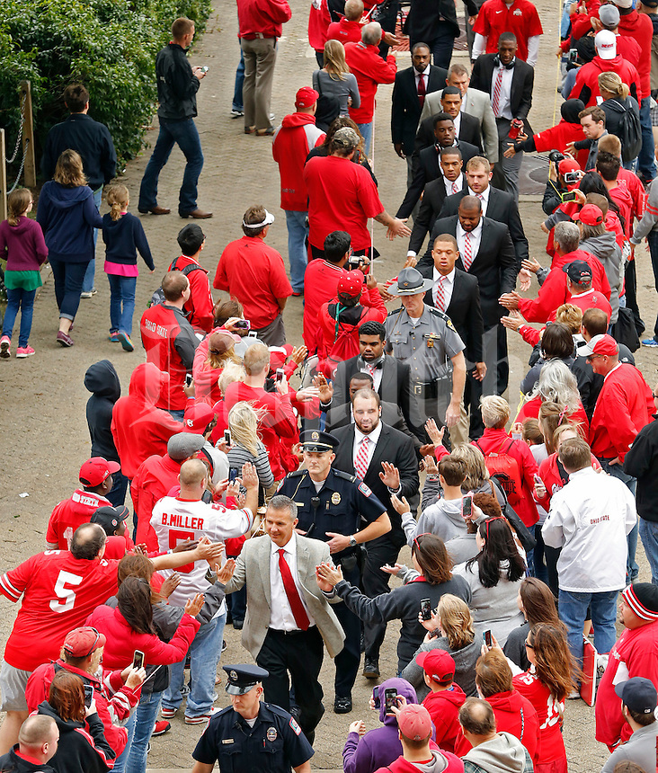 Ohio State Buckeyes head coach Urban Meyer and the Buckeyes football team walk into the stadium for their game against Kent State Golden Flashes in Ohio Stadium on September 13, 2014.  (Dispatch photo by Kyle Robertson)