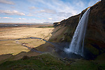 SELJALANDSFOSS - ICELAND - MAY 09, 2012: Seljalandsfoss is a waterfall between Selfoss and Skógafoss at the Ring Road. It drops down about 60 m  over the cliffs of the former coastline. (Photo by Dirk Markgraf)