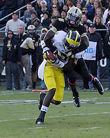 Michigan wide receiver Devin Gardner makes a 23-yard touchdown catch despite the efforts of Purdue cornerback Josh Johnson (28). The Michigan Wolverines defeated the Purdue Boilermakers 44-13 on October 6, 2012 at Ross-Ade Stadium in West Lafayette, Indiana.