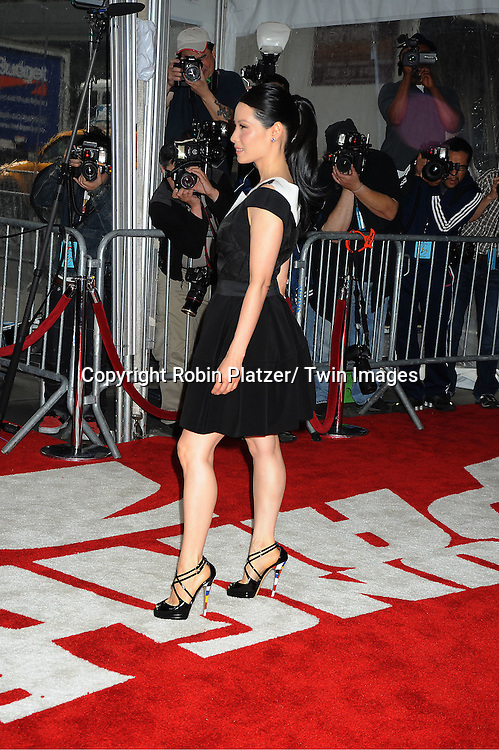 """Lucy Liu posing for photographers at The New York Premiere of .""""Kung Fu Panda 2""""  at The Ziegfeld Theatre on May 24, 2011."""