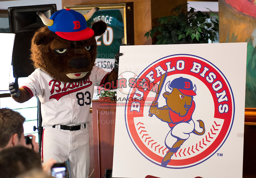 Buffalo Bisons mascot Buster T. Bisons stands next to the new logo during a press conference introducing the teams new logo and manager for their affiliation with the Toronto Blue Jays at Coco-Cola Field on November 20, 2012 in Buffalo, New York.  (Mike Janes/Four Seam Images)