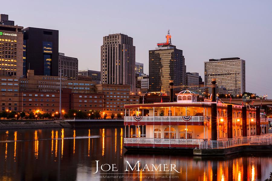 Saint Paul, Minnesota skyline with river boat at dusk.