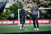 Seattle, WA - Sunday, May 1, 2016: Seattle Reign FC head coach Laura Harvey and FC Kansas City head coach Vlatko Andonovski chat prior a National Women's Soccer League (NWSL) match at Memorial Stadium.