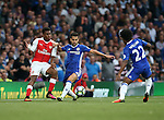 Arsenal's Alex Iwobi tussles with Chelsea's Cesc Fabregas during the Premier League match at the Emirates Stadium, London. Picture date September 24th, 2016 Pic David Klein/Sportimage