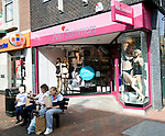 Ann Summers shop with girls sitting outside, Ipswich, England