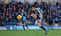 Luke O'Nien of Wycombe Wanderers controls the ball during the Sky Bet League 2 match between Wycombe Wanderers and Oxford United at Adams Park, High Wycombe, England on 19 December 2015. Photo by Andy Rowland.
