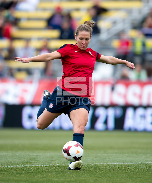 USWNT midfielder Lauren Holiday strikes the ball during practice at Crew Stadium in Columbus, OH.