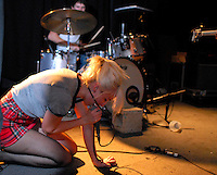"Singer Jemina Pearl kneels in front of drummer John Eatherly as their Nashville punk band ""Be Your Own Pet"" performs at Maxwells in Hoboken, NJ"