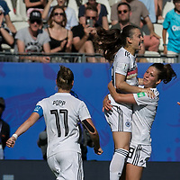 GRENOBLE, FRANCE - JUNE 22: Sara Daebritz #13 of the German National Team celebrates her penalty kick goal with teammates during a game between Nigeria and Germany at Stade des Alpes on June 22, 2019 in Grenoble, France.
