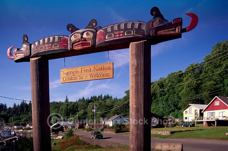 Kwakwaka'wakw (Kwakiutl) Welcome Sign to Namgis First Nation at Alert Bay, Cormorant Island, BC, British Columbia, Canada - Sisiutl Figure on Poles